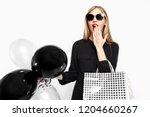 elegant shocked girl  in black... | Shutterstock . vector #1204660267