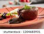 hot chocolate fondant with mint ... | Shutterstock . vector #1204683931