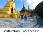 woman tourist is traveling and... | Shutterstock . vector #1204724344