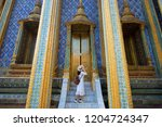 woman tourist is traveling and... | Shutterstock . vector #1204724347