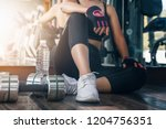 woman in black fitness suite... | Shutterstock . vector #1204756351