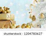 heap of golden gifts or... | Shutterstock . vector #1204783627