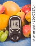 glucose meter with result sugar ... | Shutterstock . vector #1204792714