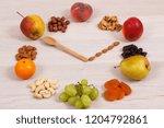 clock made of ripe fruits... | Shutterstock . vector #1204792861