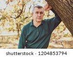 senior man with a sad... | Shutterstock . vector #1204853794