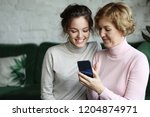 family  people and technology.... | Shutterstock . vector #1204874971