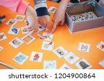 children hands touching white...   Shutterstock . vector #1204900864
