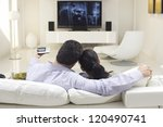 rear view of couple watching tv ... | Shutterstock . vector #120490741