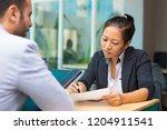 pensive asian executive manager ...   Shutterstock . vector #1204911541