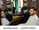 handsome bearded man at the... | Shutterstock . vector #1204922854