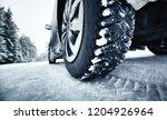 closeup of car tires in winter... | Shutterstock . vector #1204926964
