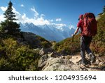 a man hiking on the famous tour ... | Shutterstock . vector #1204935694