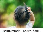 a girl scratch on her hair. the ... | Shutterstock . vector #1204976581