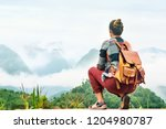 traveler sits at the edge of... | Shutterstock . vector #1204980787
