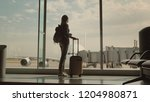 a woman with a travel bag and... | Shutterstock . vector #1204980871