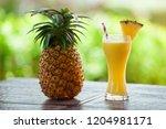 fresh pineapple juice with... | Shutterstock . vector #1204981171
