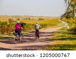 a couple riding the bike with... | Shutterstock . vector #1205000767