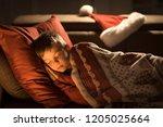 cute little boy sleeping on the ... | Shutterstock . vector #1205025664