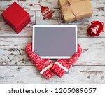 tablet on christmas background | Shutterstock . vector #1205089057