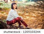beautiful girl in the autumn... | Shutterstock . vector #1205103244