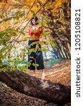 beautiful girl in the autumn... | Shutterstock . vector #1205108821