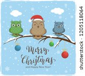 three colorful owls with santa... | Shutterstock .eps vector #1205118064