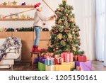 adorable preteen kid in santa... | Shutterstock . vector #1205150161