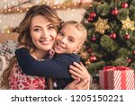 smiling mother and daughter... | Shutterstock . vector #1205150221