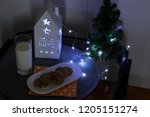 cookies and milk for santa claus | Shutterstock . vector #1205151274