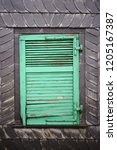 a rotten shutter of a window on ... | Shutterstock . vector #1205167387