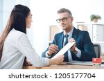 insurance agent pointing at... | Shutterstock . vector #1205177704