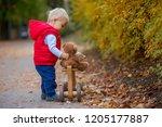 little toddler boy with teddy... | Shutterstock . vector #1205177887