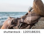 young girl in a plaid sitting...   Shutterstock . vector #1205188201