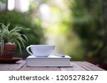 white cup with plant and... | Shutterstock . vector #1205278267