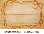Wooden background with a christmas gold garland - stock photo