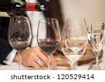 serving wine. | Shutterstock . vector #120529414