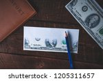 counterfeiter forges banknotes. ... | Shutterstock . vector #1205311657