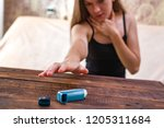 an asthmatic person is trying... | Shutterstock . vector #1205311684