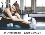 fitness asian woman doing yoga... | Shutterstock . vector #1205339194