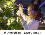 little girl  decorates a... | Shutterstock . vector #1205348584