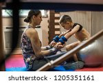 physical therapist assisting...   Shutterstock . vector #1205351161