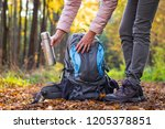 traveler is taking thermos out... | Shutterstock . vector #1205378851