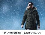 a handsome brutal man wearing a ... | Shutterstock . vector #1205396707