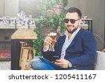 modern fashionable guy using... | Shutterstock . vector #1205411167