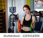athlete blogger making a video | Shutterstock . vector #1205416504