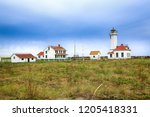 Small photo of Port Townsend, WA, USA - October 11, 2015: The Point Wilson Lighthouse is an active aid to navigation located in Fort Worden State Park near Port Townsend, Jefferson County, Washington State.
