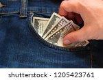hand stealing money from the... | Shutterstock . vector #1205423761