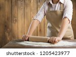 making dough by female hands at ... | Shutterstock . vector #1205423977