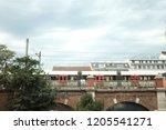 subway overground train passing ... | Shutterstock . vector #1205541271