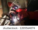 closeup of man wearing mask... | Shutterstock . vector #1205564074
